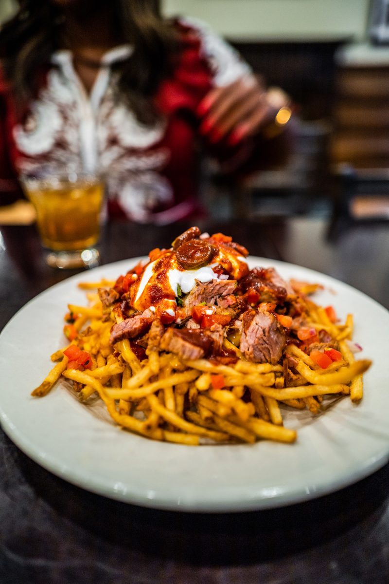 Doc Crow's Southern Smokehouse and Raw Bar    Louisville KY Road Trip by popular LA travel blogger, Alicia Tenise: image of a plate of fries.