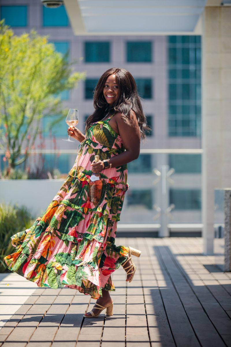 Farm Rio Pink Cocoa Forest Maxi Dress | Colorful Dresses by popular LA fashion blogger, Alicia Tenise: image of Alicia Tenise wearing a Farm Rio Coco print maxi dress, cork block heel sandals, and holding a glass of wine.