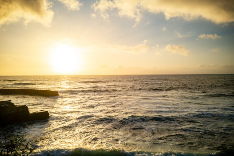 Packing List by popular LA travel blogger, Alicia Tenise: image of the sun setting over the ocean.